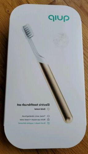 electric toothbrush sonic gold metal with toothpaste